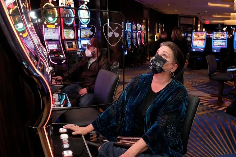 Debbie Lynch of Burlington County plays the Buffalo Inferno slot machine at the Hard Rock Hotel & Casino Atlantic City in December.