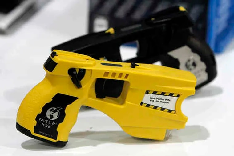 A Taser-like device was used by a security guard on South Street early Saturday, causing a man's clothes to burst into flames.