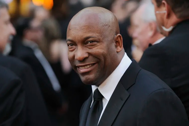FILE - In this Feb. 24, 2008 file photo, director John Singleton arrives at the 80th Academy Awards in Los Angeles. Oscar-nominated filmmaker John Singleton has died at 51, according to statement from his family, Monday, April 29, 2019. He died Monday after suffering a stroke almost two weeks ago.