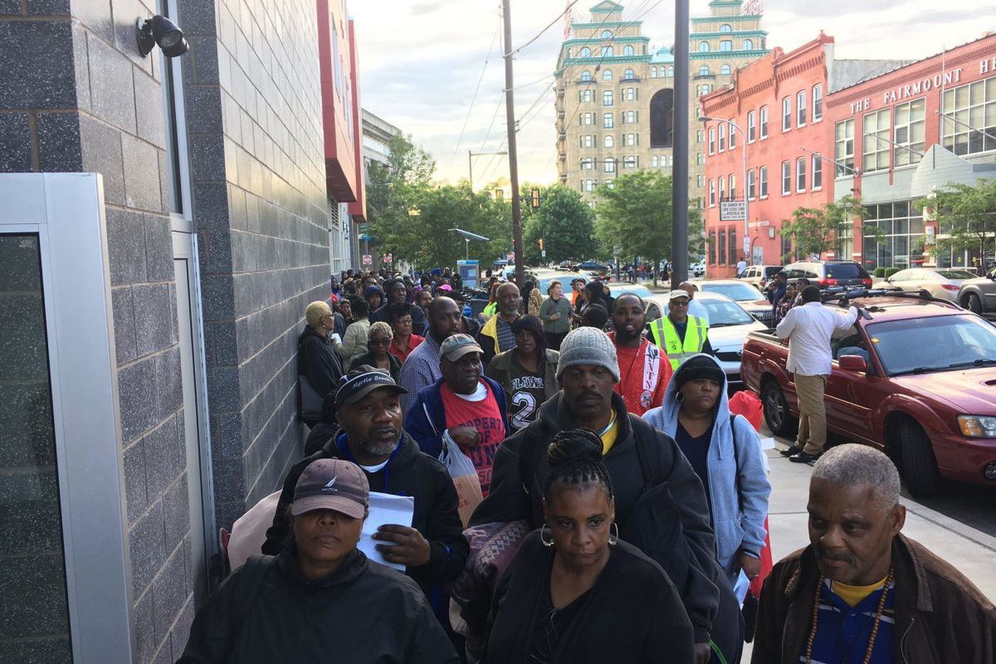 On Fairmount Avenue, hundreds line up for a shot at a home