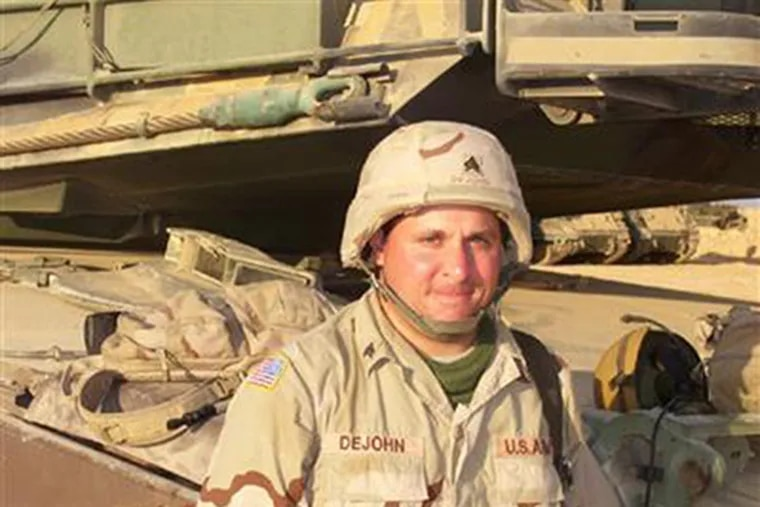 Christian DeJohn in the Sahara Desert, near Alevandria, Egypt. He was an M1 Abrams tank gunner so he's standing next to his tank during a multinational wargame. He served with the 1/104th Cavalry, US Army. (Photo courtesy Christian DeJohn)