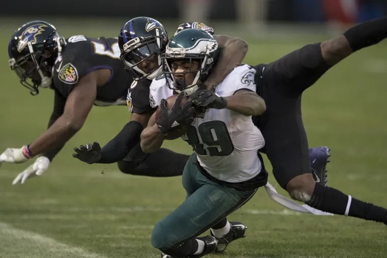 Eagles'  Byron Marshall is brought down by Ravens' Tavon Young in the fourth quarter.