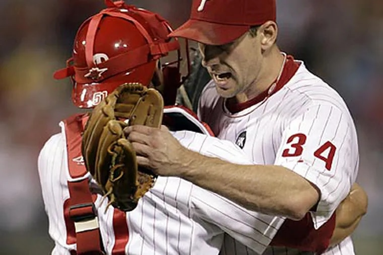 Carlos Ruiz and Cliff Lee celebrate after Lee pitched a complete-game shutout against the Nationals. (Yong Kim/Staff Photographer)