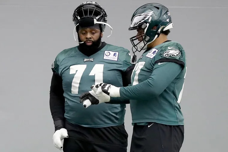 Eagles tackle Jason Peters (left) has helped teammate Andre Dillard (right) even as Dillard has worked to replace Peters as the starting left tackle.