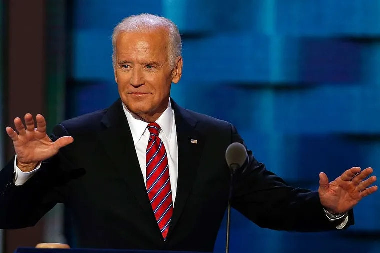 Vice President Joe Biden raises his arms before addressing delegates during Day 3 of the DNC at the Wells Fargo Center in South Philadelphia.