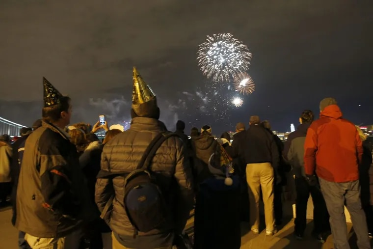 Spectators watch fireworks over the Delaware River on Dec. 31, 2016. A change in Pennsylvania law means state residents can now put on bigger displays on their own.