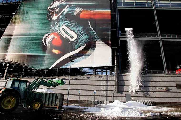 Crews remove snow from Lincoln Financial Field in advance of the Eagles-Vikings game that was postponed and moved to Tuesday night. More on C3.