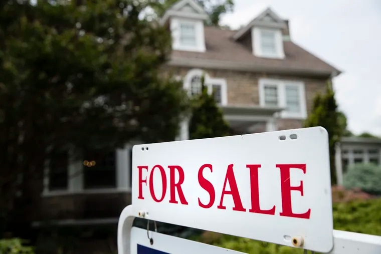 In this 2018 file photo, a for sale sign stands in front of a house in Jenkintown. A lack of supply of homes for sale is holding back the housing market, which has been a bright spot in a pandemic-battered economy.