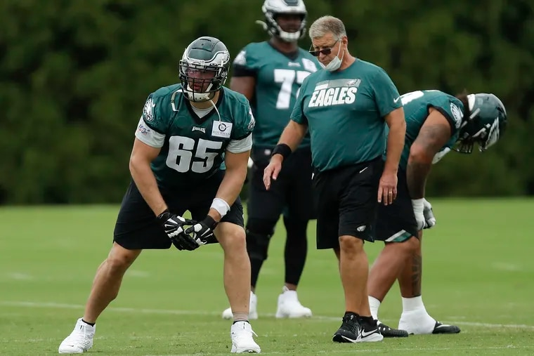 Eagles offensive tackle Lane Johnson (left) gets into position as Offensive line/Run game coordinator Jeff Stoutland looks on during practice at the NovaCare Complex in South Philadelphia on Friday, September 11, 2020.