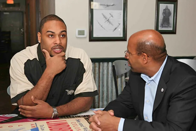 Temple product Raheem Brock, shown with Mayor Nutter, is happy to give back to the community. (BIZCOM PR)