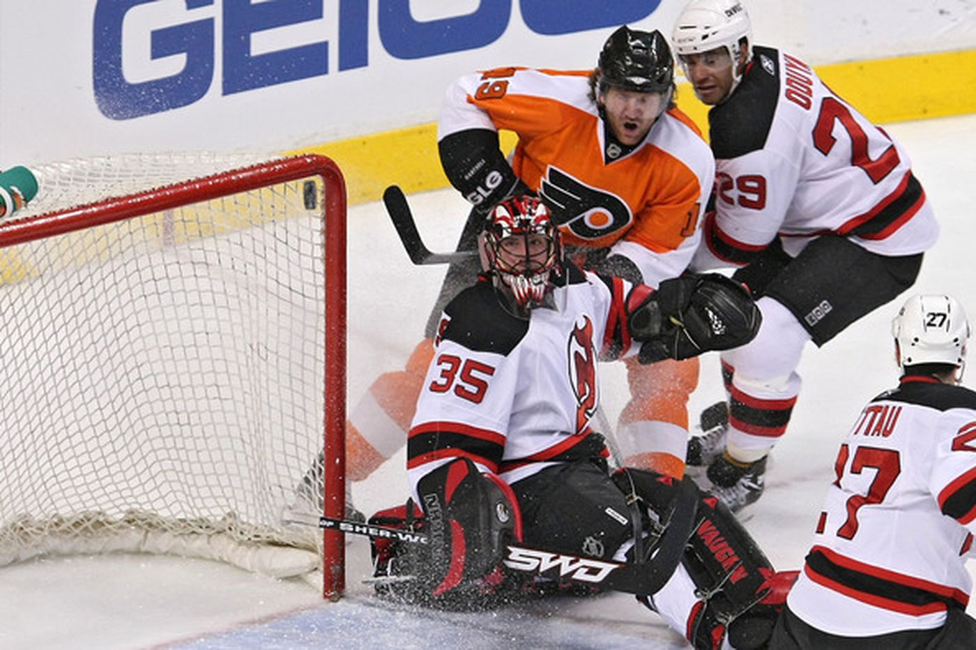 With Devils' Brodeur out, Flyers' Gagne can't chat with friendly foe