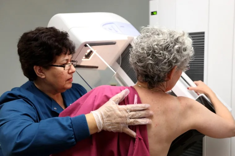 Blanca Rubio performs a mammogram on a 65-year-old patient at Evanston Hospital in Evanston, Illinois.