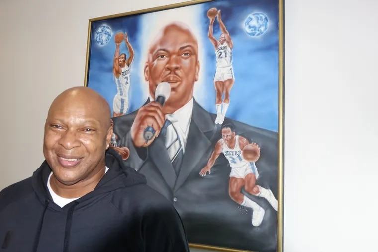 Former Sixers player and current team ambassador, World B. Free, shown in his office, will be inducted into the Small College Basketball Hall of Fame. Free was a star at Guilford College.