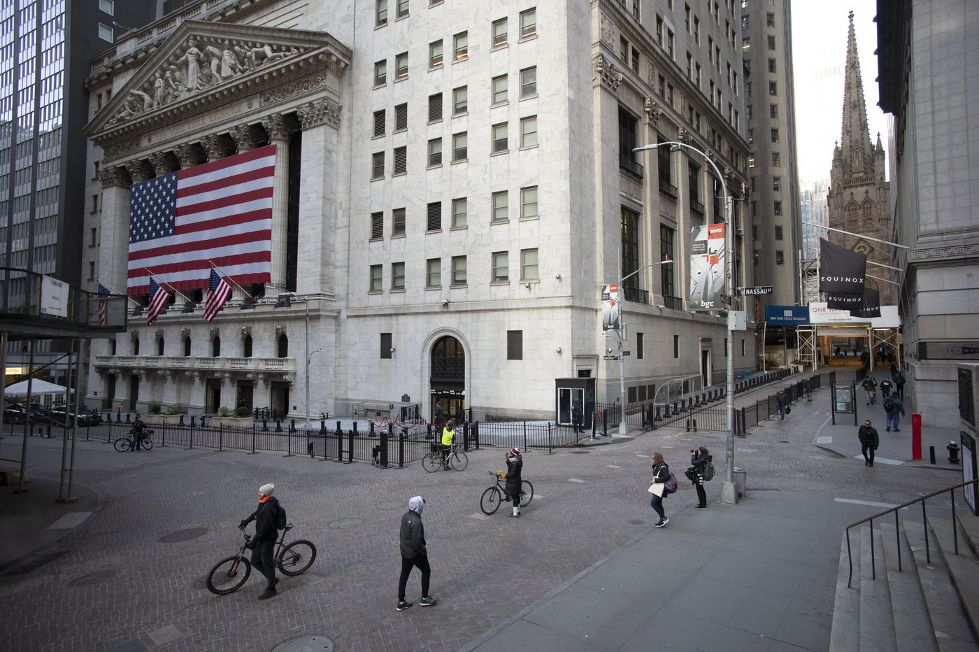 Stocks fall on Wall Street despite Federal Reserve aid, as coronavirus relief bill stalls again