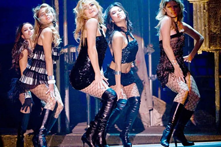The musical numbers, featuring Kate Hudson (third from left) and others, offer bump-and-grind choregraphy and little variety.