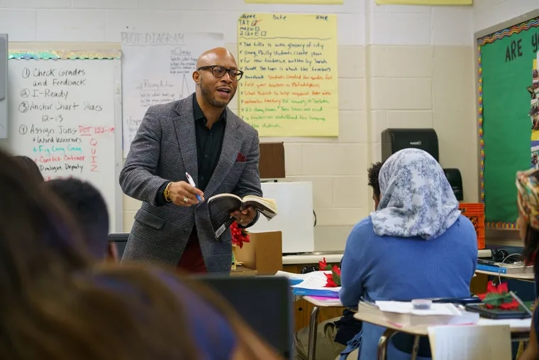 """Herman Douglas teaches at Bethune Elementary School in North Philadelphia. He leads the """"Men of Bethune,"""" a group of African American teachers organized to support one another and lift up their students. JESSICA GRIFFIN / Staff Photographer"""
