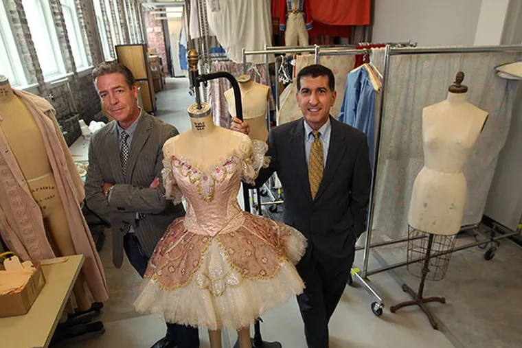 Roy Kaiser, Pennsylvania Ballet Artistic Director, left, and Executive Director Michael Scolamiero, right, in the costume shop on North Broad Street. ( MICHAEL BRYANT / Staff Photographer  )