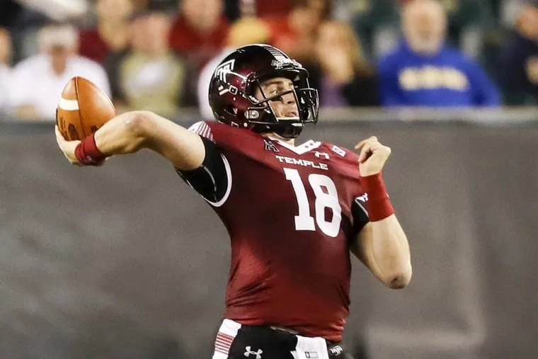 Temple quarterback Frank Nutile throws a pass during the third quarter against Navy.