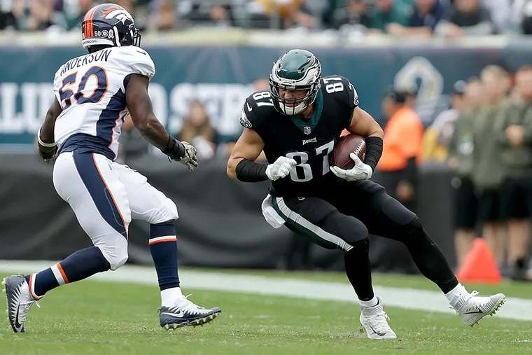 Eagles' Brent Celek (right) catches a pass as the Broncos' Zaire Anderson defends.