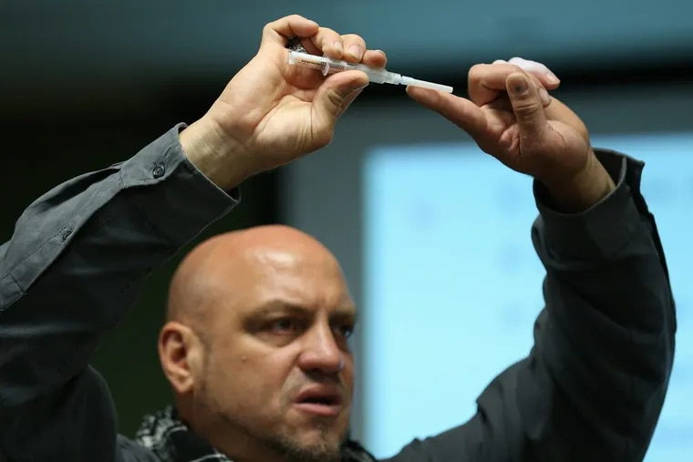 Elvis Rosado of Prevention Point Philadelphia shows families whose loved ones are addicted how to administer Narcan, a nasal spray version of the opioid overdose reversal medication naloxone, during a two-hour training on Wednesday, Dec. 13. The city Department of Behavioral Health plans more sessions in the new year.