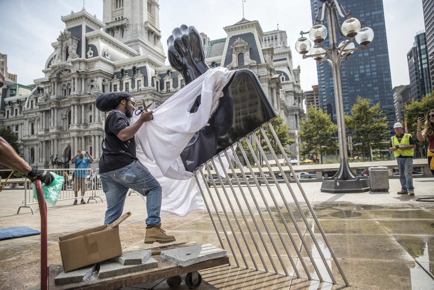 Mural Arts adds an Afro pick sculpture to the plaza with Rizzo's statue