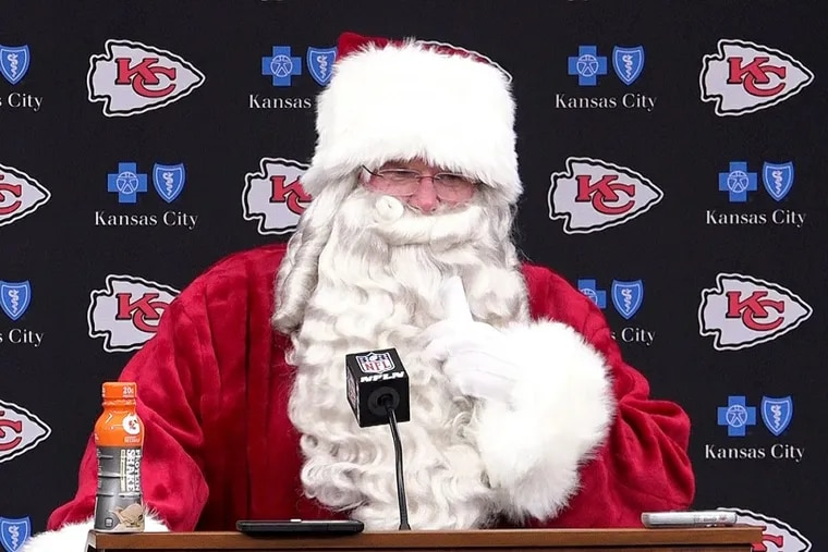 Kansas City Chiefs head coach Andy Reid arrives dressed as Santa Claus for his post game press conference after Sunday's 29-13 win over the Miami Dolphins on Dec. 24, 2017 at Arrowhead Stadium in Kansas City, Mo.