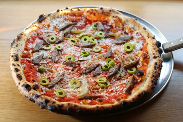 The lamb pizza at 24 Wood-fired fare, 2401 Walnut St. Friday February 17, 2017.