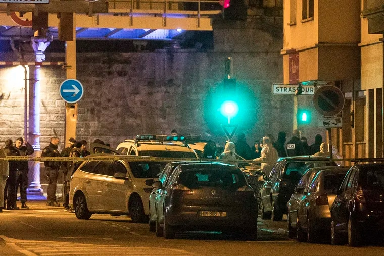Investigating police officers work in a street of Strasbourg, eastern France, Thursday Dec. 13, 2018. A top French official says a man has been killed in a shootout with police in Strasbourg, but he has not been confirmed as the suspected gunman who killed three people near a Christmas market. (AP Photo/Jean-Francois Badias)