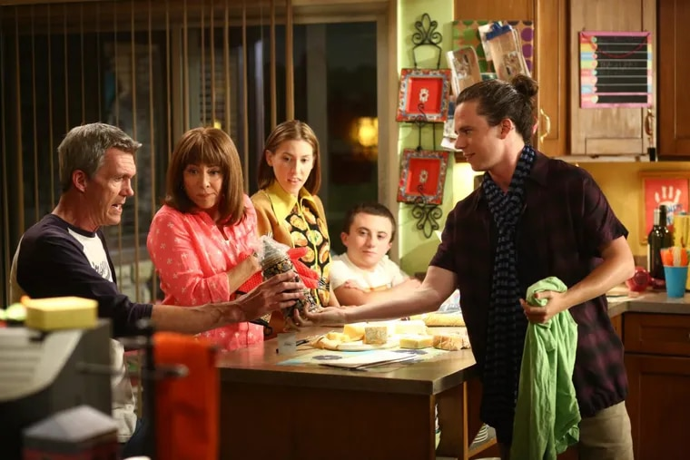"""In the final season premiere of ABC's """"The Middle"""" on Tuesday, Axl (Charlie McDermott, right) returns home from his summer trip to Europe and gets together with his family (from left): Mike (Neil Flynn), Frankie (Patricia Heaton), sister Sue (Eden Sher), and brother Brick (Atticus Shaffer)."""