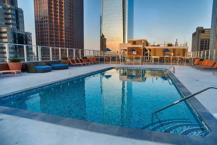 Rooftop pools and other amenities can drive up apartment costs.