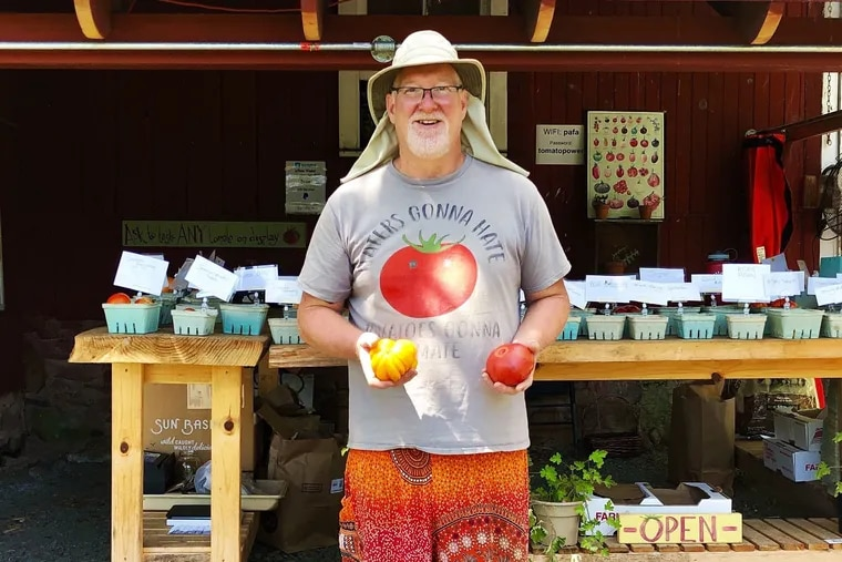 Farmer Dan Waber in front of the farm stand at his Rainbow Tomatoes Garden in East Greenville, Montgomery County, where he grows 320 varieties of heirloom tomatoes and also sells what he bills as the world's largest collection of tinned fish.