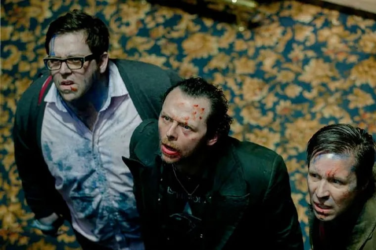 """Longtime school chums (from left) Nick Frost, Simon Pegg, and Paddy Considine find something's amiss in their old town in """"The World's End."""" (Focus Features)"""