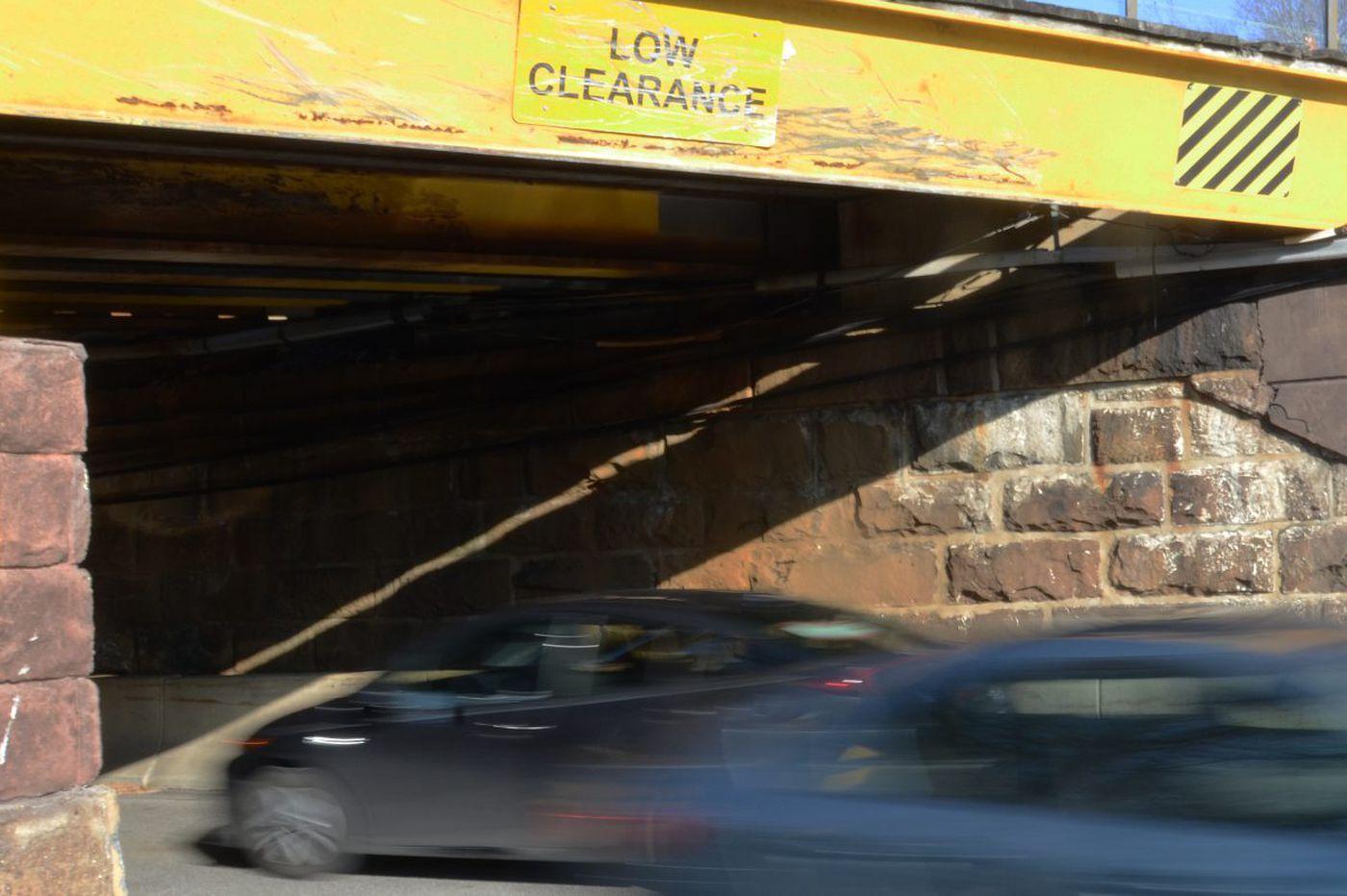 Tell us: Are trucks slamming into bridges in your neighborhood, too?