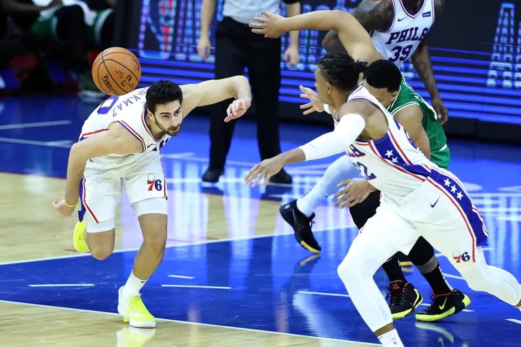 Furkan Korkmaz, left, and Matisse Thybulle of the Sixers go after a loose ball as they come up with a steal against the  Celtics during the second half of a preseason game at the Wells Fargo Center on Tuesday.