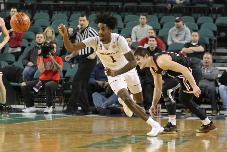 Temple's Quinton Rose, left, steals a pass intended Luke Frampton, right, of Davidson for  and breakaway dunk to defeat Davidson in overtime during the Boardwalk Classic at Boardwalk Hall in Atlantic City on Dec. 15, 2018.    CHARLES FOX / Staff Photographer