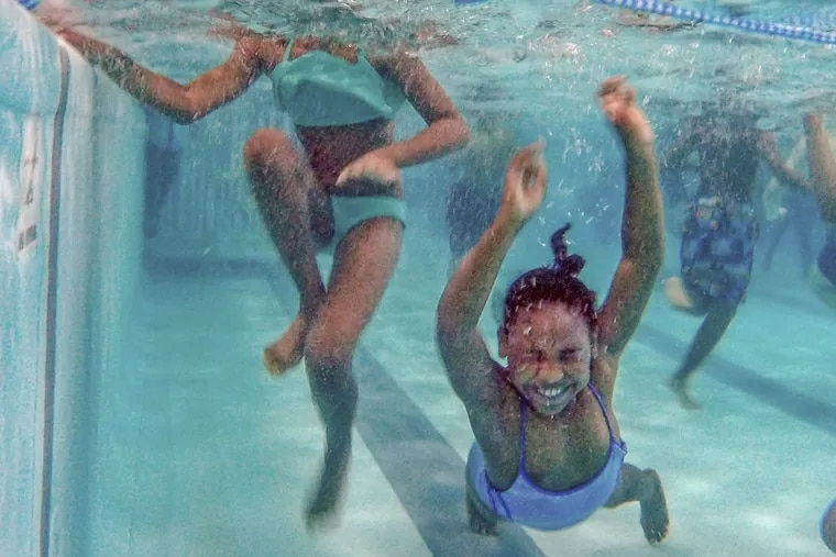 Heaven Gonzalez, 8, closes her eyes and goes under the water during her swim time at the Germantown Life Enrichment Center.