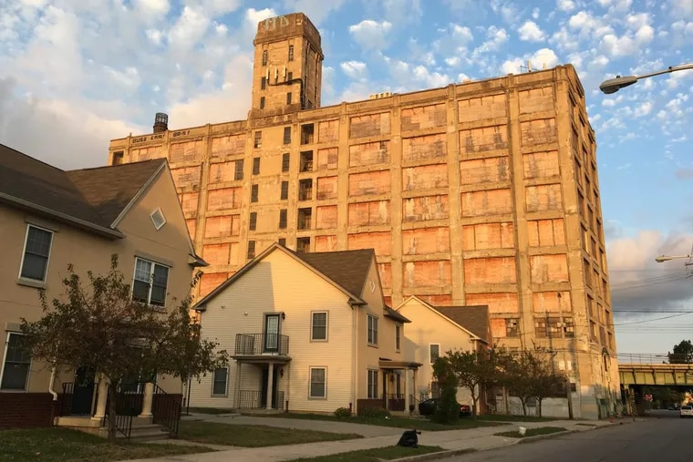 The Quaker warehouse was built by Strawbridge & Clothier to store furniture and was served by the adjacent railroad. Today, it is an industrial survivor in the low-rise, suburban-style neighborhood of West Poplar.
