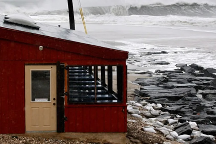 The dining area of The Cove restaurant in Cape May, N.J., is threatened by the rough Atlantic Ocean on Monday, as Hurricane Sandy continued toward landfall. (AP Photo/Mel Evans)