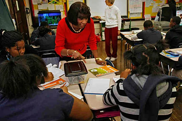 Reading teacher Eloise Overby (foreground) and math teacher Joanne Fidler work with students at Spring Garden School, which outperforms schools with similar student populations. (Alejandro A. Alvarez/Staff)