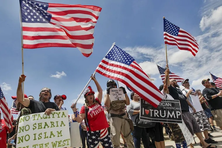 """In June, anti-Sharia protesters chanted """"USA!"""" and waved signs, including one that said """"Islam is not American,"""" near the Inland Regional Center in San Bernardino, Calif., where a Pakistani American couple fatally shot 14 people in 2015."""