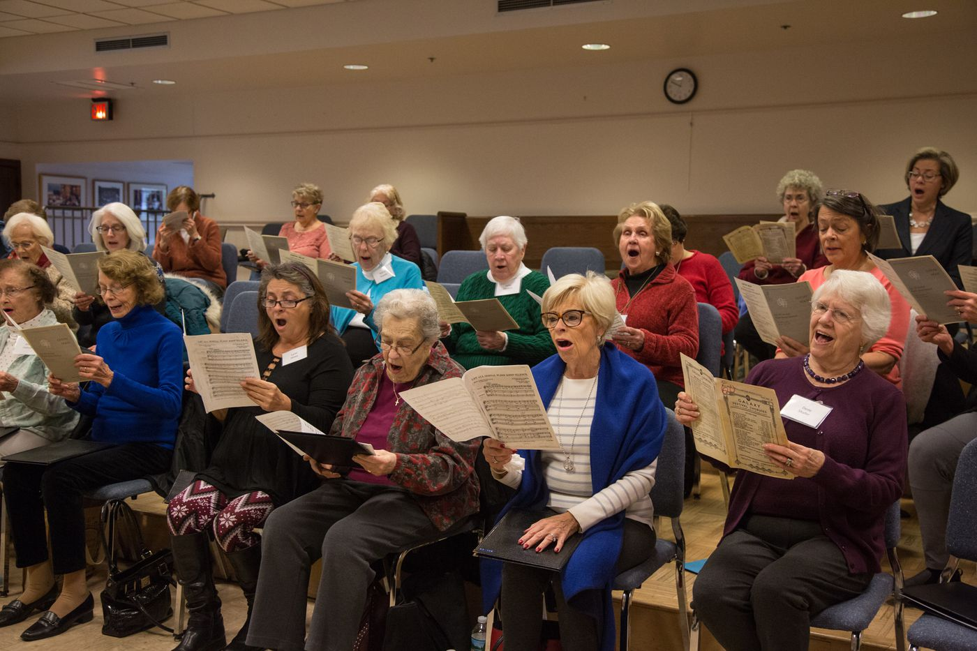 The members of the Singing for Life choir join together for their weekly choral practice at Bryn Mawr Presbyterian Church. EMILY COHEN / For the Inquirer