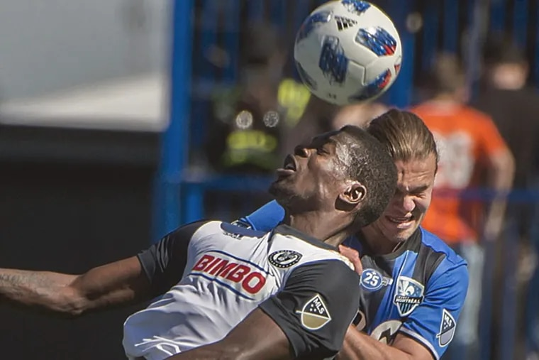 Philadelphia Union forward Cory Burke jumps to contest a ball in the air with Montreal Impact midfielder Samuel Piette.