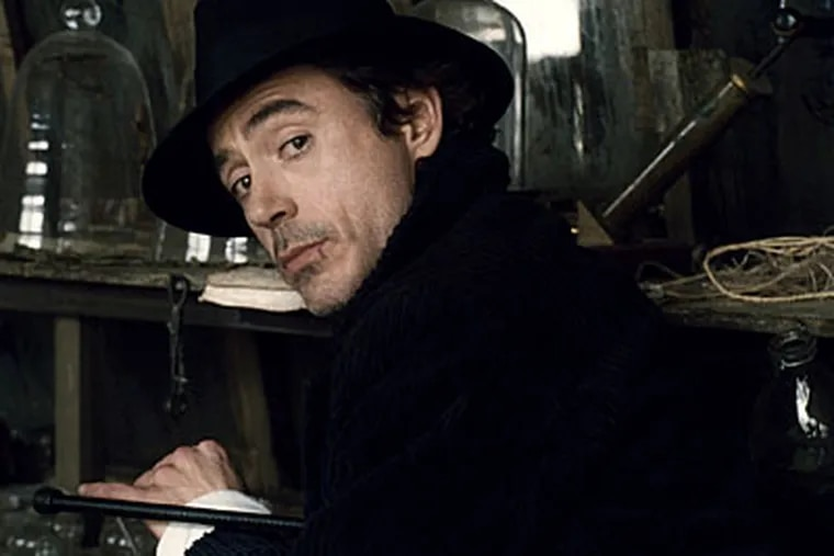 """Guy Ritchie's """"Sherlock Holmes"""" is violence with an impish sense of humor, and he may have found the perfect imp in Robert Downey Jr."""
