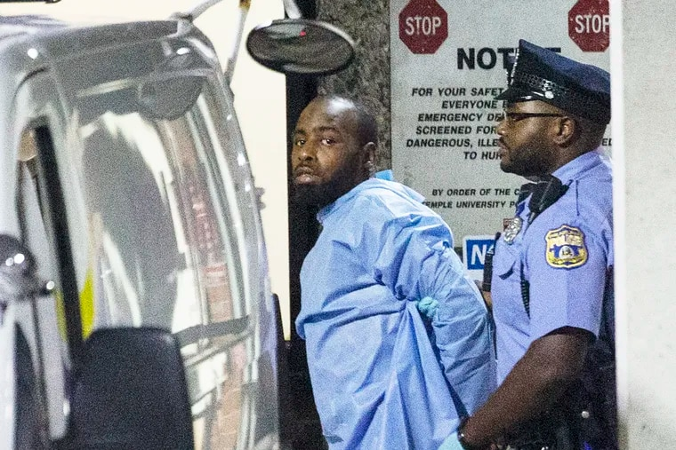 At 3:30 am the suspect, Maurice Hill, was walked from Temple University Hospital's emergency room to a waiting Philadelphia police van.