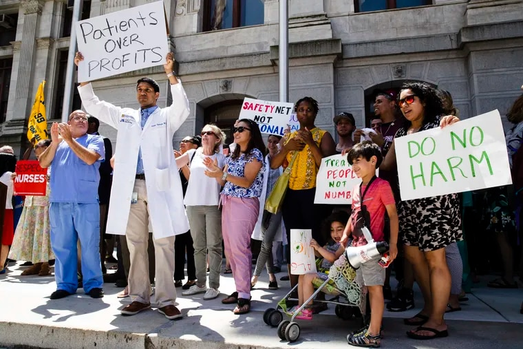 """Protesters demonstrate against the planned closure of Hahnemann University Hospital, at City Hall in Philadelphia, Thursday, June 27, 2019. The owner of hospital has announced it will close in September because of what the company calls """"continuing, unsustainable financial losses."""""""