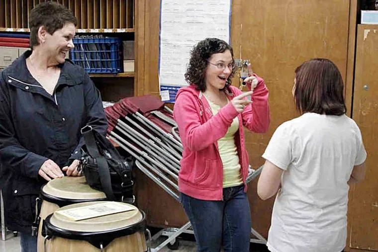 In 2011, Sandy Capasso watches daughter Kaytlynn, 16, and Victoria Kuhnel, all of Penns Grove, discuss their auditions at the Fine and Performing Arts Academy at Glassboro High, an Interdistrict Public School Choice Program.