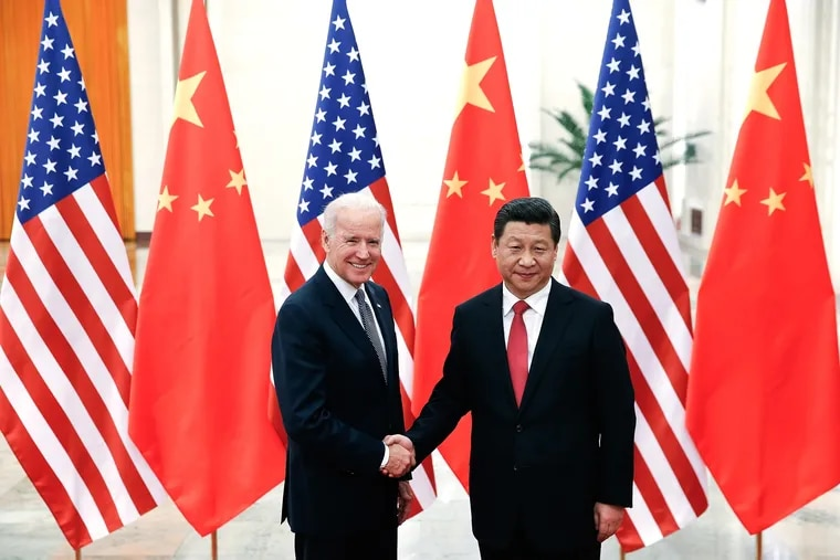 Chinese President Xi Jinping, right, shakes hands with then U.S. Vice President Joe Biden inside the Great Hall of the People in 2013, in Beijing.