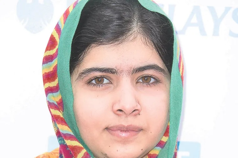 Pakistani educational activist Malala Yousafzai poses for photographers as she arrives for We Day at Wembley Arena in London, March 7, 2014. (Photo by Joel Ryan/Invision/AP Images)