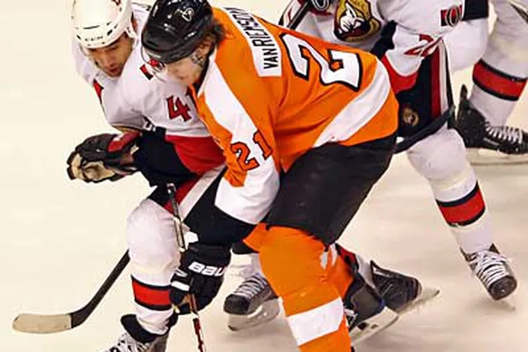 Flyers' James van Riemsdyk and  Senators' Jonathan Cheechoo square off during the 3rd period in NHL action at the Wachovia Center on Thursday night.  ( Steven M. Falk / Staff Photographer )