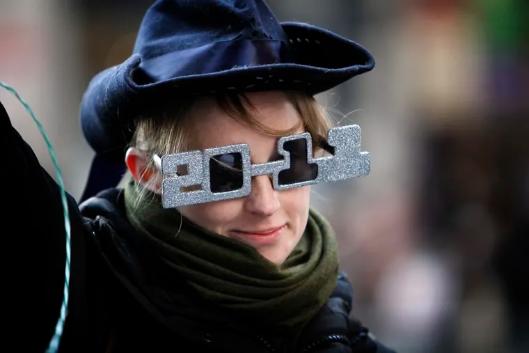 Karla Bussel sports her 2011 glasses as she struts up Broad Street with the Comics in the Mummers Parade on Jan. 1, 2011, which some say ushered in the new decade.